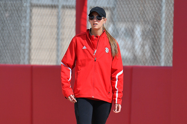 ALBUQUERQUE, NEW MEXICO - FEBRUARY 28, 2020:  Assistant coach Christy Warnock looks on during her team's game against the Northern Colorado Bears in the Lobo Classic at the Lobo Softball Field on February 28, 2020 in Albuquerque, New Mexico.  (Photo by Sam Wasson for South Dakota Athletics)
