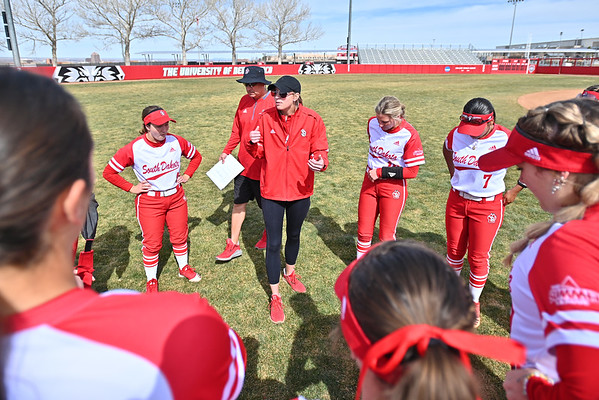 ALBUQUERQUE, NEW MEXICO - FEBRUARY 28, 2020:  Assistant coach Christy Warnock of the South Dakota Coyotes talks to her team before their game against the Northern Colorado Bears  in the Lobo Classic at the Lobo Softball Field on February 28, 2020 in Albuquerque, New Mexico.  (Photo by Sam Wasson for South Dakota Athletics)