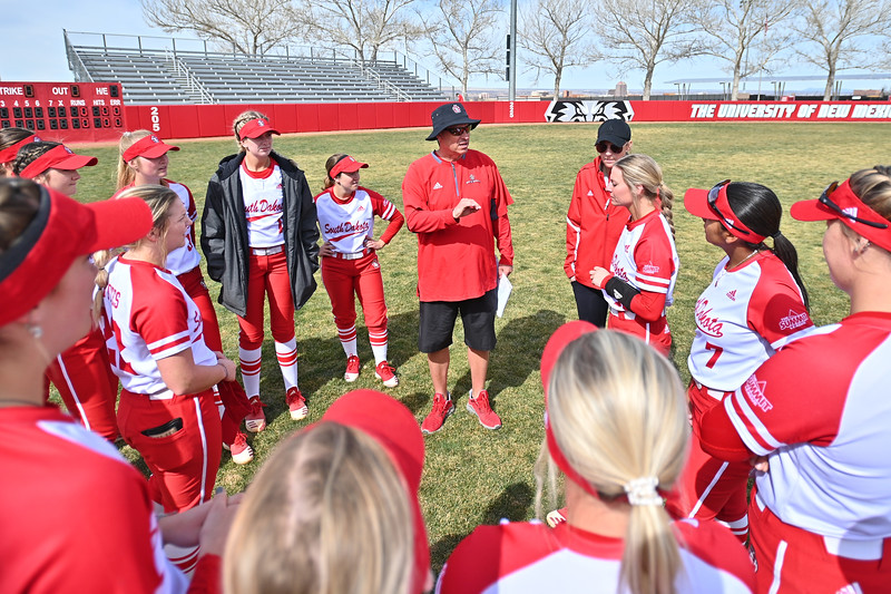 ALBUQUERQUE, NEW MEXICO - FEBRUARY 28, 2020:  head coach Robert Wagner of the South Dakota Coyotes talks to his team before their game against the Northern Colorado Bears in the Lobo Classic at the Lobo Softball Field on February 28, 2020 in Albuquerque, New Mexico.  (Photo by Sam Wasson for South Dakota Athletics)