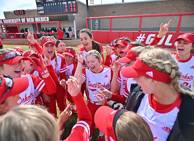 ALBUQUERQUE, NEW MEXICO - FEBRUARY 28, 2020:  The South Dakota Coyotes huddle before their game against the Northern Colorado Bears in the Lobo Classic at the Lobo Softball Field on February 28, 2020 in Albuquerque, New Mexico.  (Photo by Sam Wasson for South Dakota Athletics)