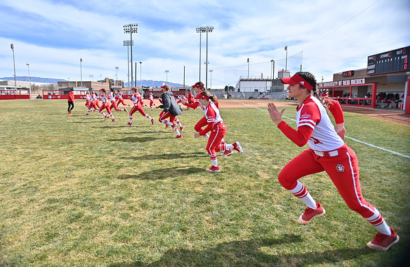 ALBUQUERQUE, NEW MEXICO - FEBRUARY 28, 2020:  The South Dakota Coyotes warm up before their game against the Northern Colorado Bears in the Lobo Classic at the Lobo Softball Field on February 28, 2020 in Albuquerque, New Mexico.  (Photo by Sam Wasson for South Dakota Athletics)
