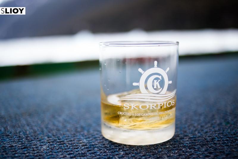 Drinking whiskey with glacial ice on the Skorpios III Kaweskar route in Patagonia's Bernardo O'Higgins National Park.