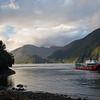 A ferry boat departs Caleta Gonzalo in Chilean Patagonia's Parque Pumalin.