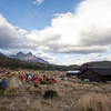 Breaking camp at Refugio Paine Grande on the Torres del Paine circuit trek, with the Cuernos in the background.