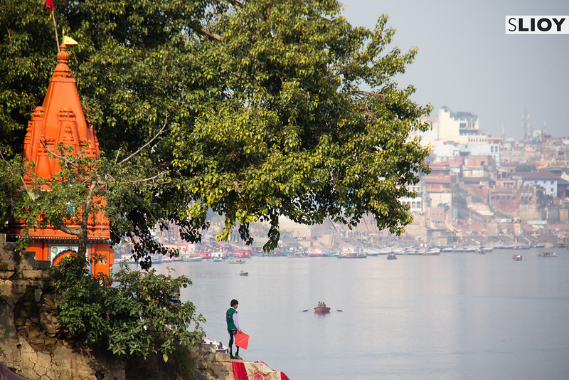 Boy with a kite overlooking the Ganges River in Varanasi, India.