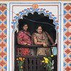 Two women watch events unfold at the Sita Bibiha festival in Janakpur, Nepal