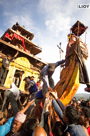 Handing out treats from the chariot of Bhairab during Bisket Jatra.