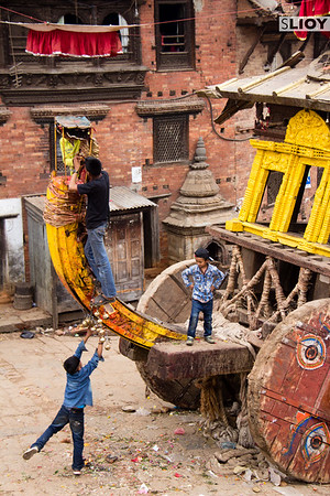 Kids playing on a chariot during a break in the action at Bisket Jatra festival 2015.
