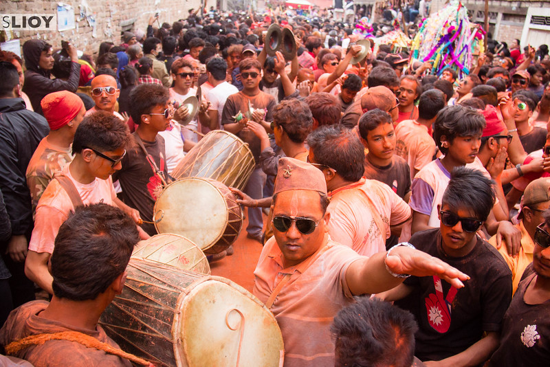Musicians gather in the crowd to herald the arrival of the Sunder Jatra volunteer, who will soon mount a stage to pierce his tongue in a ceremony that reaches back over 100 years.