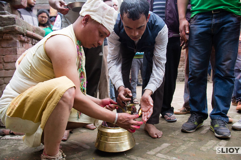 Preparing for the Sunder Jatra - this man makes his way through the village of Bode to stop at every small shrine and make a devotional offering.