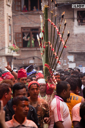 After piercing his tongue, a local man proceeds through the village of Bode bearing a fiery bamboo trellis on his back. This event, known as the Sunder Jatra, is part of the larger Bisket Jatra festival celebrated in the nearby city of Bhaktapur in Nepal.