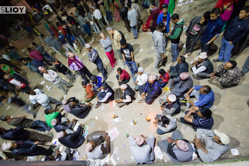 A drum circle plays the crowds stream past in the center of Bhaktapur during Bisket Jatra.