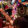 Carrying these shrines through the dense Sunder Jatra crowd is hard work.