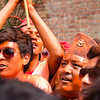 Vermillion crowds watch the Sunder Jatra, as a local man pierces his tongue with a steel rod.