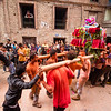Crowds carry shrines through the village of Bode before the start of the Sunder Jatra tongue piercing, part of the large Bisket Jatra festival in Bhaktapur.
