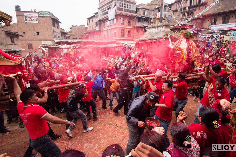 The collision of two shrines during the Bisket Jatra festival. These collisions represent the historic relations between the various gods represented by the shrines.