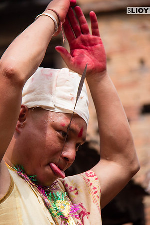Waving to the crowd after the ritual tongue piercing of the Sunder Jatra festival in the Nepalese village of Bode.