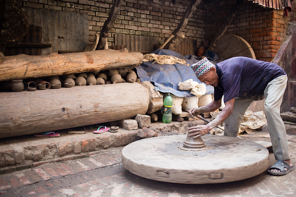 Artisan potter working in the streets of Bhaktapur Pottery Square near Kathmandu Nepal.