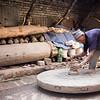 Artisan potter working in the streets of Bhaktapur Pottery Square near Kathmandu Nepal.