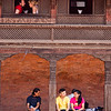 Locals and tourists alike gather at the old Bhaktapur palace square in Nepal's Kathmandu Valley.
