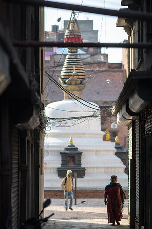 A monk on the backstreets of Kathmandu's Boudhanath Stupa in Nepal.