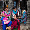 Local women rest beside a main square of Patan in Nepal's Kathmandu Valley.