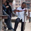 A local man reads tourist literature on the streets of Patan in Nepal's Kathmandu Valley.
