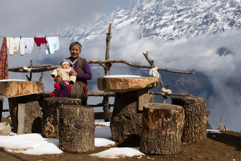 The owner of a guesthouses at the top of the Nagthali Ghyang La pass along the Tamang Heritage Trail in Nepal.