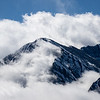 Clouds cover snowy mountains along the Tamang Heritage Trail in Nepal.