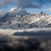 Clouds cover snowy mountain peaks along the Tamang Heritage Trail in Nepal.