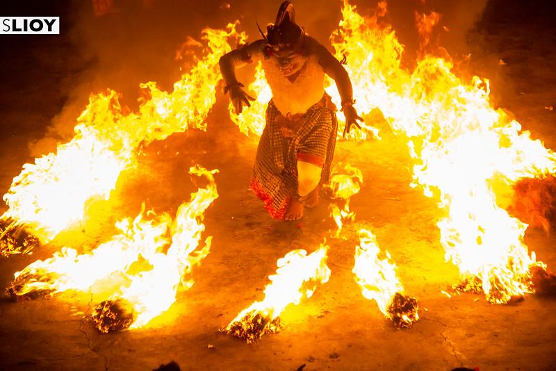 Hanuman the monkey dancing with fire at the kecak dance in Bali's Uluwatu temple.