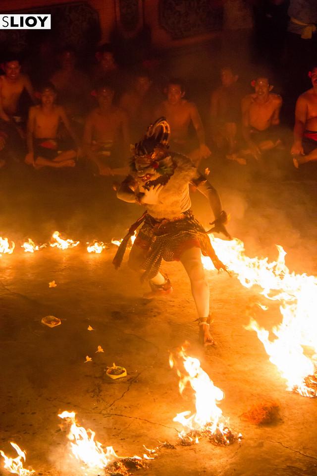 Hanoman dancing in fire at the kecak monkey dance in Uluwatu temple Bali.