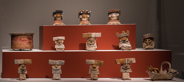 Figurines and a Vessel