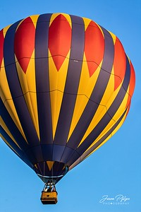 Hot air balloon floating in the blue sky. Enjoy and hold hands.