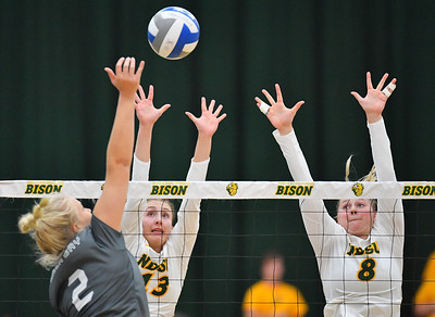 FARGO, NORTH DAKOTA - SEPTEMBER 14, 2019:  Alexis Bachmeier #13 and Bella Lien #8 of the North Dakota State Bison go up for a block against Alexis Dorner #2 of the Green Bay Phoenix during their match at the Bentson Bunker Fieldhouse on September 14, 2019 in Fargo, North Dakota. North Dakota State defeated Green Bay 3-0.  (Photo by Sam Wasson)