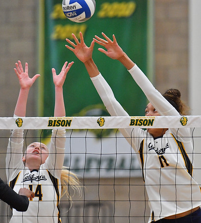 FARGO, NORTH DAKOTA - SEPTEMBER 13, 2019:  Jade Blevins #14 and Lauren Forte #11 of the Cal Bears go up for a block against the Buffalo Bulls during their match at the Bentson Bunker Fieldhouse on September 13, 2019 in Fargo, North Dakota.  (Photo by Sam Wasson)