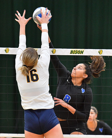 FARGO, NORTH DAKOTA - SEPTEMBER 13, 2019:  Kristina Nieves #8 of the Buffalo Bulls attacks a ball against Savannah Rennie #16 of the Cal Bears during their match at the Bentson Bunker Fieldhouse on September 13, 2019 in Fargo, North Dakota.  (Photo by Sam Wasson)