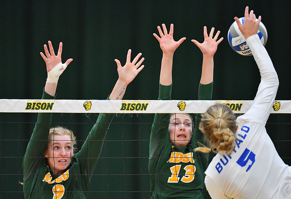 FARGO, NORTH DAKOTA - SEPTEMBER 14, 2019:  Emily Halverson #9 and Alexis Bachmeier #13 of the North Dakota State Bison go up for a block against Abby Leigh #5 of the Buffalo Bulls during their match at the Bentson Bunker Fieldhouse on September 14, 2019 in Fargo, North Dakota. North Dakota State defeated Buffalo 3-2.  (Photo by Sam Wasson)