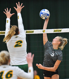 FARGO, NORTH DAKOTA - SEPTEMBER 14, 2019:  Shannon Coughlin #3 of the Green Bay Phoenix attacks against Allie Mauch #2 of the North Dakota State Bison during their match at the Bentson Bunker Fieldhouse on September 14, 2019 in Fargo, North Dakota. North Dakota State defeated Green Bay 3-0.  (Photo by Sam Wasson)