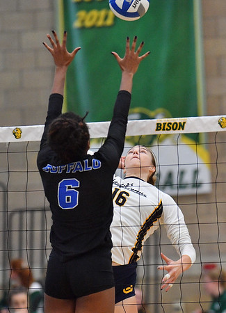 FARGO, NORTH DAKOTA - SEPTEMBER 13, 2019:  Savannah Rennie #16 of the Cal Bears attacks a ball against Rachel Sanks #6 of the Buffalo Bulls during their match at the Bentson Bunker Fieldhouse on September 13, 2019 in Fargo, North Dakota.  (Photo by Sam Wasson)