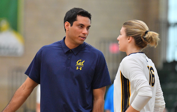 FARGO, NORTH DAKOTA - SEPTEMBER 13, 2019:  Head coach Sam Crosson of the Cal Bears talks to Savannah Rennie #16 during their match against the Buffalo Bulls at the Bentson Bunker Fieldhouse on September 13, 2019 in Fargo, North Dakota.  (Photo by Sam Wasson)