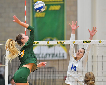 FARGO, NORTH DAKOTA - SEPTEMBER 14, 2019:  Syra Tanchin #3 of the North Dakota State Bison attacks a ball against Monika Simkova #14 of the Buffalo Bulls during their match at the Bentson Bunker Fieldhouse on September 14, 2019 in Fargo, North Dakota. North Dakota State defeated Buffalo 3-2.  (Photo by Sam Wasson)