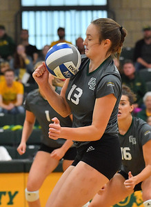 FARGO, NORTH DAKOTA - SEPTEMBER 14, 2019:  Anna Eaton #13 of the Green Bay Phoenix tries to dig a ball against the North Dakota State Bison during their match at the Bentson Bunker Fieldhouse on September 14, 2019 in Fargo, North Dakota. North Dakota State defeated Green Bay 3-0.  (Photo by Sam Wasson)