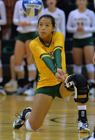 ANCHORAGE, AK - SEPTEMBER 9:  Keala Kaio-Perez #4 of the Alaska Anchorage Seawolves digs a ball in a match between the Alaska Anchorage Seawolves and the Cal State San Bernardino Coyotes at the Alaska Airlines Center in Anchorage, Alaska. The Coyotes won 3-2.  (Photo by Sam Wasson)