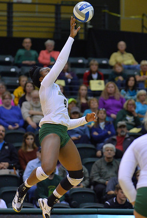 ANCHORAGE, AK - SEPTEMBER 9:  Chrisalyn Johnson #9 of the Alaska Anchorage Seawolves tips a ball over the net in a match between the Alaska Anchorage Seawolves and the Cal State San Bernardino Coyotes at the Alaska Airlines Center in Anchorage, Alaska. The Coyotes won 3-2.  (Photo by Sam Wasson)