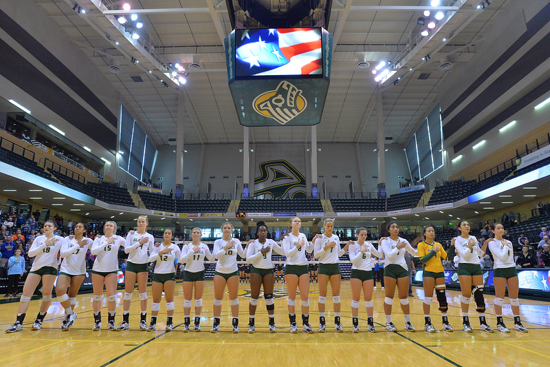 ANCHORAGE, AK - SEPTEMBER 9:  The UAA Seawolves line up for the American National Anthem in a match between the Alaska Anchorage Seawolves and the Cal State San Bernardino Coyotes at the Alaska Airlines Center in Anchorage, Alaska. The Coyotes won 3-2.  (Photo by Sam Wasson)