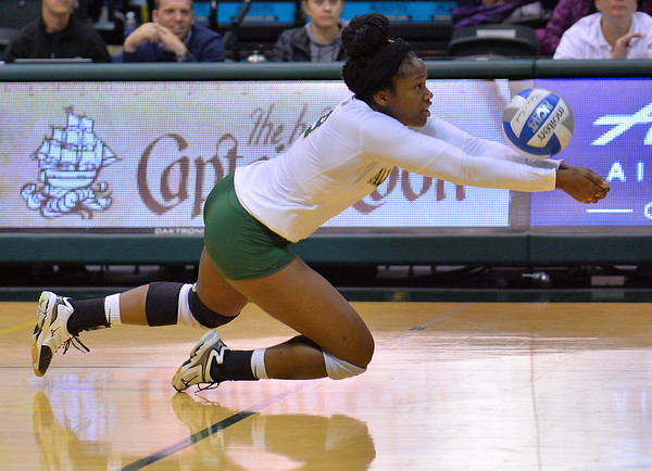 ANCHORAGE, AK - SEPTEMBER 9:  Chrisalyn Johnson #9 of the Alaska Anchorage Seawolves dives for a dig in a match between the Alaska Anchorage Seawolves and the Cal State San Bernardino Coyotes at the Alaska Airlines Center in Anchorage, Alaska. The Coyotes won 3-2.  (Photo by Sam Wasson)