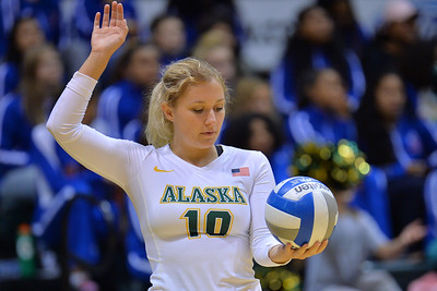 ANCHORAGE, AK - SEPTEMBER 9:  Madison Fisher #10 of the Alaska Anchorage Seawolves serves a ball in a match between the Alaska Anchorage Seawolves and the Cal State San Bernardino Coyotes at the Alaska Airlines Center in Anchorage, Alaska. The Coyotes won 3-2.  (Photo by Sam Wasson)