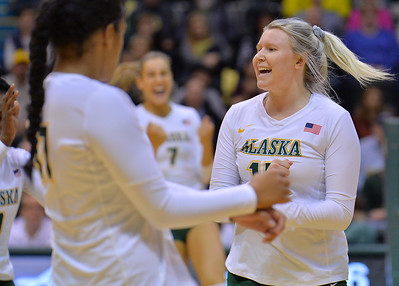 ANCHORAGE, AK - SEPTEMBER 9:  Tara Melton #15 of the Alaska Anchorage Seawolves celebrates after her team wins a point in a match between the Alaska Anchorage Seawolves and the Cal State San Bernardino Coyotes at the Alaska Airlines Center in Anchorage, Alaska. The Coyotes won 3-2.  (Photo by Sam Wasson)