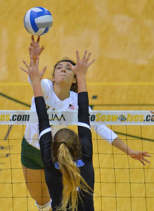 ANCHORAGE, AK - SEPTEMBER 9:  Anais Vargas #3 of the Alaska Anchorage Seawolves tips a ball over the net in a match between the Alaska Anchorage Seawolves and the Cal State San Bernardino Coyotes at the Alaska Airlines Center in Anchorage, Alaska. The Coyotes won 3-2.  (Photo by Sam Wasson)